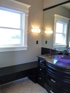 Madison's Bedroom Suite  2nd vanity with purple glass sink and window bench.