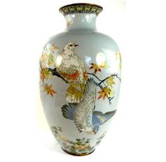 "A large and impressive antique Japanese Meiji cloisonne vase decorated with birds amongst foliage. The vase is unmarked however it is in the style ofNamikawa Sosuke. Dates Meiji period C1862-1912. Measures 46cm 18"" tall. 