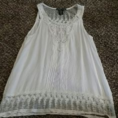 Lacey white tank top. Light flowy loose tank top with lace details. It is nice just not really my style. Never been worn. Tops Tank Tops