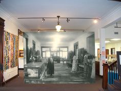 The interior of the Johnson County Museum in Franklin Indiana with the inset of how it looked when it was the Masonic Temple in the 1920s