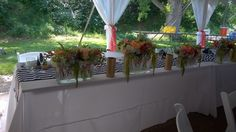 lake water - stripes - head table - flowers by The French Tulip in Oklahoma City