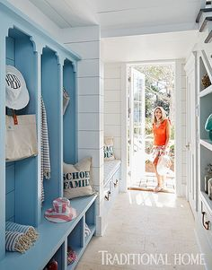 """The mudroom feature cubbies painted in Benjamin Moore's """"Heaven on Earth."""" Wall paint color is Benjamin Moore Decorator's White."""
