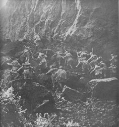 """Caption: """"An Italian advance in difficult conditions As often happens in the fighting on the Austro-Italian front, these Italian soldiers scramble over jagged rocks and up precipitous slopes. In this instance, they took advantage of the confusion..."""
