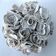 Polymer clay artist Angela Schwer sculpts botanical beauties.