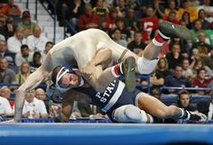 17 MAR 2012:  Frank Molinaro of Penn State University, bottom, wrestles Dylan Ness of the University of Minnesota during the Division I Men's Wrestling Championship held at Scottrade Center in St. Louis, MO.  Molinaro defeated Ness 4-1 to take the 149 lb national title.Mark Buckner/NCAA Photos