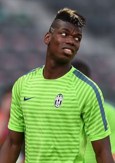 promo code 86ead 7b5e4 Paul Pogba of Juventus looks on during a Juventus training session on the  eve of the