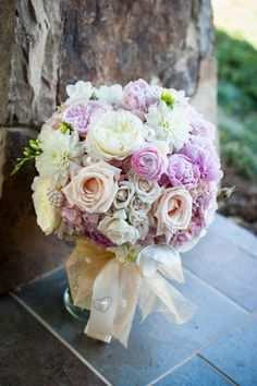 Large #bridalBouquet filled with blush #pinkhydrangeas, #sandroses, #whitefreesia, #whiteranunculus.  Wrapped in ivory satin with rhinestone broach. long #pearlpins inserted throughout!  Stunning!