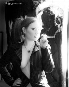 A few Beautiful Women also love Cigars!