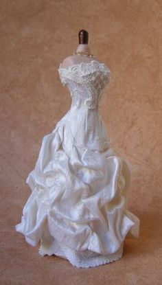 Antique white silk 12th scale bridal gown which falls into a mass of ruffles…