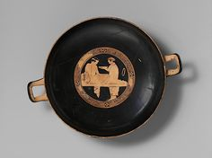 Terracotta kylix (drinking cup) featuring a kline. http://www.metmuseum.org/collection/the-collection-online/search/250800 On display at the Metropolitan Museum of art.