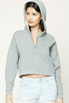 A knit hoodie featuring a partial zip-up front, fleece lining, long sleeves, and a boxy silhouette.