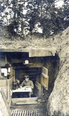 """""""One of the most extensive archives I found of war dugouts is this Flickr account of nearly 7,000 high-resolution scans of rare postcards, mostly German. The postcard above, is of a Commander Rumpf, writing at a desk outside his WWI German-built dugout. Each postcard has been meticulously labelled, scanned on both sides and translated to share the letters written by soldiers on the back."""""""