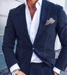 Stripes teamed up with a vintage patterned pocket square.