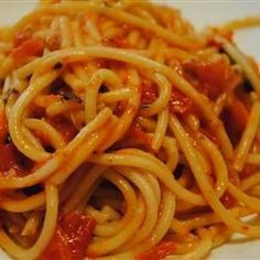 Homemade Tomato Basil Pasta Sauce Recipe Condiments and Sauces with butter, tomatoes, fresh basil, olive oil, garlic salt, salt and ground black pepper, all-purpose flour, water, garlic