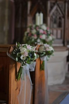 pretty cluster for ailses with roses and greenery