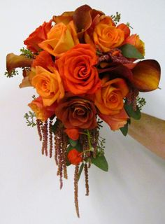 images of fall bridal bouquets | Her bridesmaids carried smaller cascading bouquets of fall colored ...