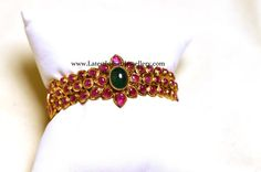 Exquisite ruby gold bangle in traditional design studded with cabochon rubies and a single emerald in the floral design. The kada style single bangle Vanki Designs Jewellery, Antique Jewellery Designs, Gold Bangles Design, Gold Jewellery Design, Ruby Bangles, Kundan Bangles, Ruby Jewelry, India Jewelry, Gold Jewelry Simple