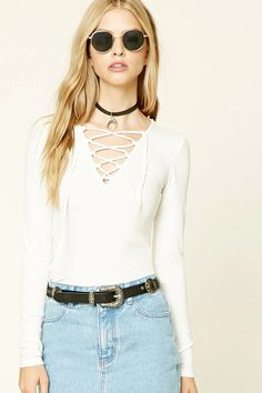 Style Deals - A ribbed knit top featuring a lace-up V-neckline and long sleeves.