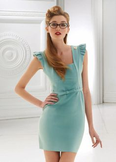 tiffany blue dress. love her hair and makeup too. not too mention her glasses too