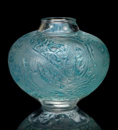René Lalique  'Aras' a Vase, design 1924  frosted glass, heightened with blue staining  22.5cm high, engraved 'R. Lalique France'