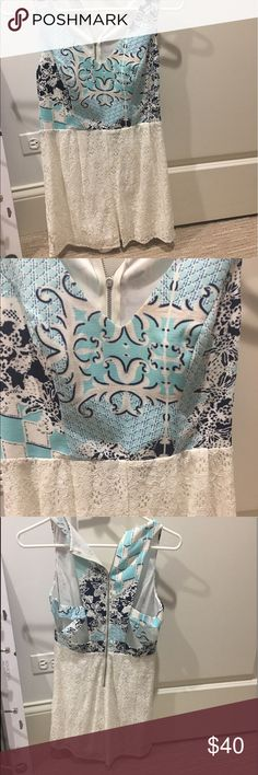 Aqua and white romper S Worn once. Bottom is white lace, and the back has parts that are open at the top. Other