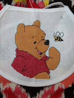 Pooh bear cross stitched bib.  Made it as a gift once.  Going to try and make it again.