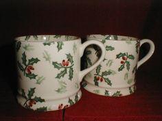 pair holly mugs.