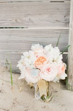 Photography: Ruth Eileen - rutheileenphotography.com  Read More: http://www.stylemepretty.com/2014/10/08/nautical-coral-mint-cape-cod-wedding/