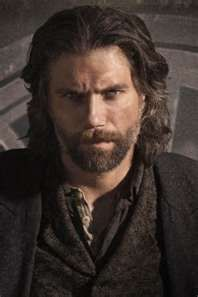 "Anson Mount...from Hell on Wheels.  There is something about him that just draws you in.  My minds eye sees him as Michael in Lisa Renee Jones' book ""The Legend of Michael"", Book 1 in the Zodius series."