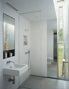 open shower. i like the mirror in the shower, next to the windows.