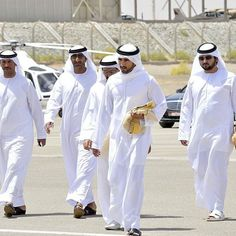 TSK TSK TSK-----VERY see through kanduras---you know they should probably invest in some thicker fabric. I mean if girls can handle the heat in black, surely the men can handle thicker white garb. African Men Fashion, Mens Fashion, Saudi Men, Dubai, Prince Crown, Royal Prince, Arab Swag, Handsome Arab Men, Arabic Dress