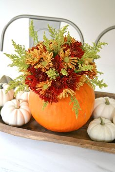 A super cute and simple DIY pumpkin centerpiece idea perfect for a fall table or Thanksgiving table idea! See more on http://ablissfulnest.com/ #falltable #pumpkinideas #falldecor