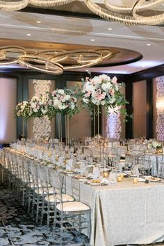 Elegant and romantic wedding with hints of pink, mauve and a pop of greenery at the Kimpton Tryon Park Hotel in Charlotte, North Carolina. | Bustld | Vetted Wedding Vendors Picked For You | #bustld #wedding #weddinginspo #weddingplanning #weddinginspiration #fallwedding #cltwedding #reception #weddingreception #seating #weddingseating