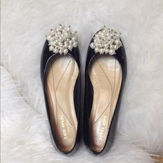 """Kate spade Abbie patent leather black flats A pearly bauble adds a pop of glamour to a very sophisticated patent leather flat.  Patent leather with padded insole. Pearly bauble on vamp. Round toe. 1/2"""" stacked heel. Slip on style. Made in Italy.  kate spade abbie patent pearl bauble flat Minor dents in leather-see pic. Only worn indoors to try and break in. Too small for me kate spade Shoes Flats & Loafers"""