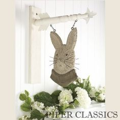 Create a striking focal point on your covered porch or inside your home with our Hanging Sign - Carved Bunny. The bracket for hanging is sold separately. #easter