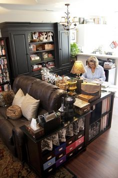 This is a great use of space! Desk behind Sofa. Make reception look like living space. Blend design library into decor.