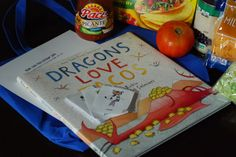 Baby (Toddler) Book Club Pals donation bag details including list of supplies and activity/snack instructions based on the book Dragons Love Tacos by Adam Rubin