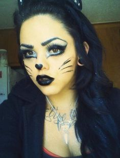 Cat Eyes halloween costume makeup. I'm doing this,minus the black lipstick.