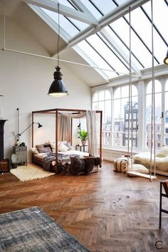 herringbone wood flooring* beautiful windows* furry seating area* indoor swing* love the openness of this space*