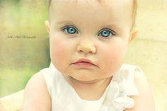 1 year pics, blue eyes, soft lighting.