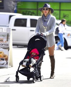 Hot child in the city: Candice Swanepoel took her sonAnacã out for a stroll in New York C...