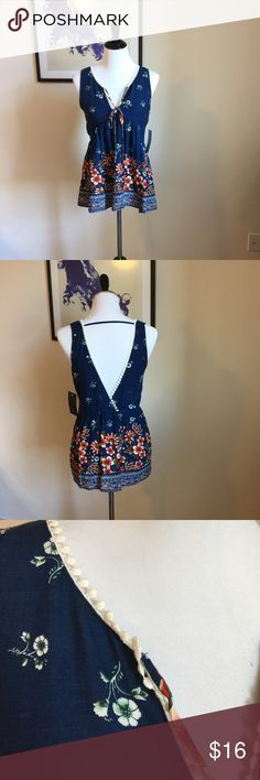 """Blue Floral top-New with tag This Floral is just in time for spring🌸 the low cut on the back just add chic stele to this top😍 Measurements: Bust: 34"""". Length: 27"""".  Bought it from designer's studio at LA fashion district. 🌸bundle to save on shipping 😘Offers are always welcomed. Tops"""
