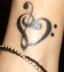 ...I'll have a musical related tattoo like this but mine will incorporate the ALTO clef too...somehow.