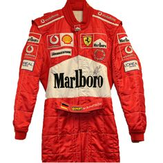 Own a Michael Schumacher Signed Race Suit!  in 2004, Schumacher was racing for Ferrari and was a strong contender for the World Championship after winning the first 3 races.  Schumacher wore this race suit at the 2004 San Marino GP where he finished in first place.  The suit is personally signed by Michael Schumacher -  a real collectors' item.  For an additional charge, we can professionally frame the race-suit to display on your wall.