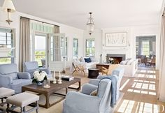 Visit Victoria Hagan's Nantucket Home : Architectural Digest - New England style, blue living room chairs, light filled family room, beautiful house House Design, Home, Beach House Decor, New Homes, Coastal Living Rooms, Coastal Style Living Room, Nantucket Home, Interior Design, Home And Living