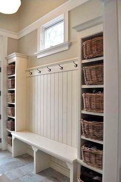 Check out this home storage idea! Organize your home with built-in hooks, a bench, and storage baskets!
