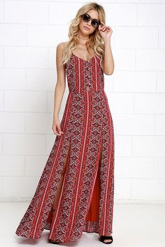You'll be a walking, talking piece of art in the Art and Craft Red Print Maxi Dress! A darted triangle bodice is supported by adjustable spaghetti straps and fastens with a mother-of-pearl button placket down the center. A red, black, and ivory tiled print adorns the woven rayon maxi skirt with two front slits. Tying waist sash.