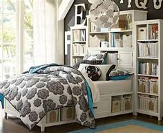 Love all the shelves around the bed and the dark wall color behind it
