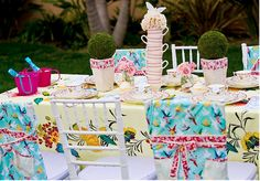 Love the idea of using a collection of vintage tablecloths to cover the backs of chairs!