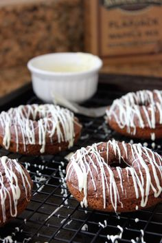 Healthy Baked Chocolate Chip Donuts... using gluten-free pancake mix from Trader Joe's and Enjoy mini chocolate chips (gluten-free & soy-free)... very easy and pretty tasty. My kids loved them even without the white/dark chocolate on top.